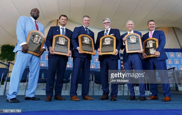 Inductees Vladimir Guerrero, Trevor Hoffman, Chipper Jones, Jack Morris, Alan Trammell and Jim Thome pose for a photograph with the plaques at Clark...