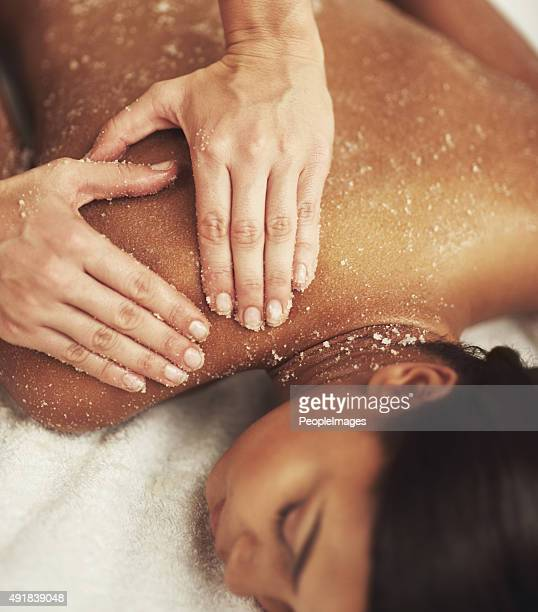 indulging a luxurious back scrub - massage stock photos and pictures