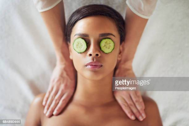 indulging in a much needed massage - cucumber stock pictures, royalty-free photos & images