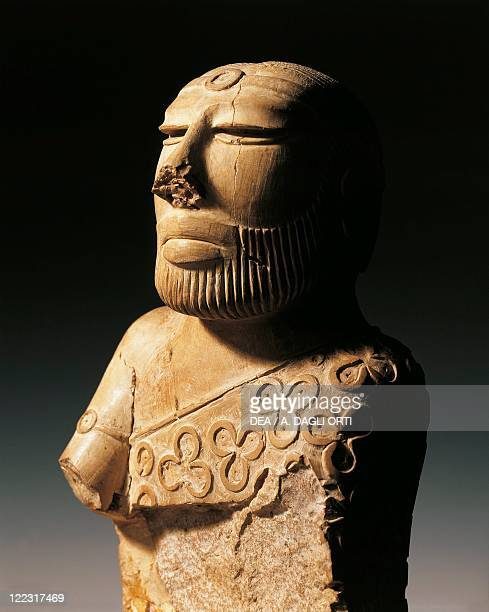 Indus Art Late period A MohenjoDaro steatite bust of the Priest King wearing a cloak decorated with trefoil once covered with a pink paste