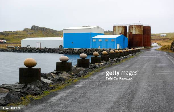 industiral zoon and storage tank at djúpivogur, iceland - austurland stock pictures, royalty-free photos & images