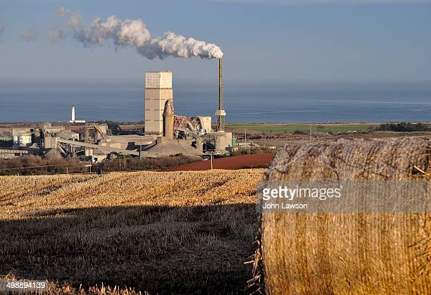 CONTENT] Industrial and agricultural image of a cement factory near Dunbar East Lothian Scotland with a hay bale in the foreground This image was...