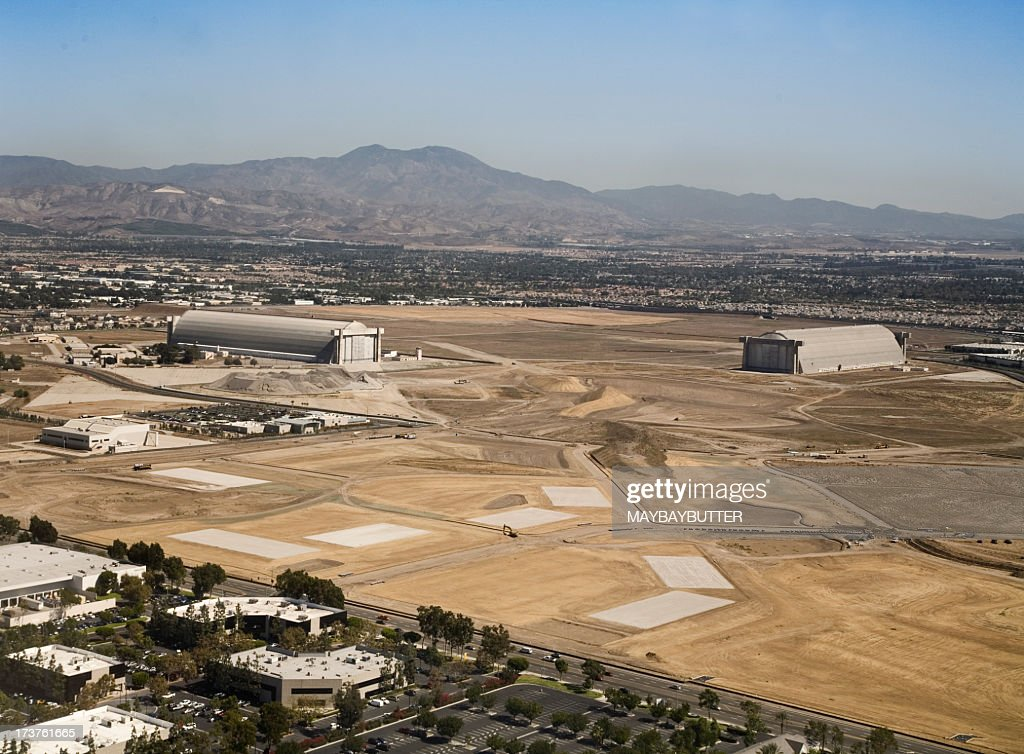 Industrial area of El Toro with mountains in background : Stock Photo