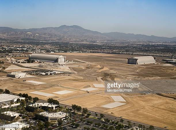 industrial area of el toro with mountains in background - base stock pictures, royalty-free photos & images