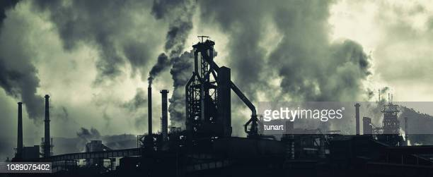 industrial area with heavy air pollution - climate stock pictures, royalty-free photos & images