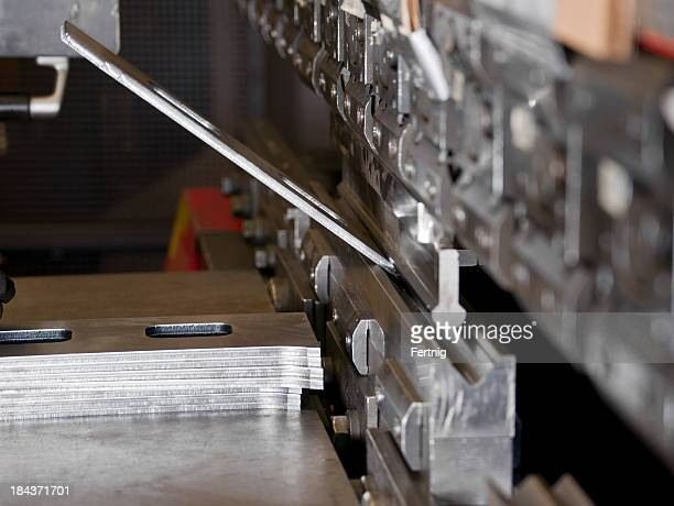 cnc industrial brake press in use - sheet metal stock pictures, royalty-free photos & images