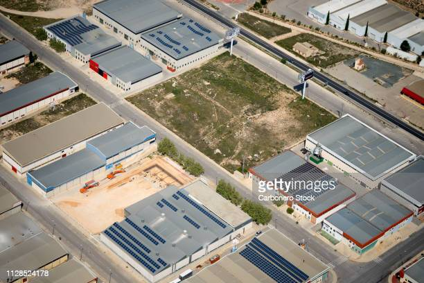 Industrial buildings with solar panels on their roofs