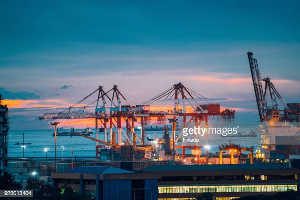 industrial cargo cranes in manila bay, philippines - manila philippines stock pictures, royalty-free photos & images