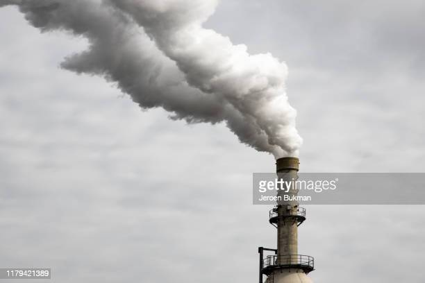 industrial chimney in operation - chimney stock pictures, royalty-free photos & images