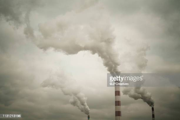 industrial chimneys smoking - smog stock pictures, royalty-free photos & images