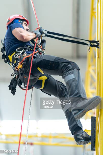 industrial climber - safety harness stock photos and pictures