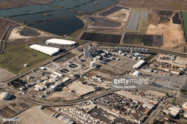industrial complex next to marshes from above - hayward california stock pictures, royalty-free photos & images