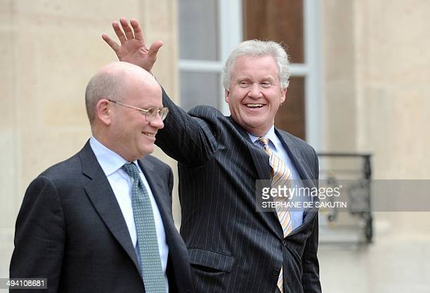 US industrial conglomerate General Electric chief executive Jeffrey Immelt flanked by Vice President Corporate Business Development at GE John...