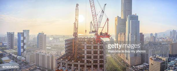 Industrial construction cranes and buildings