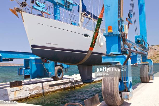 Industrial crane downloading a boat