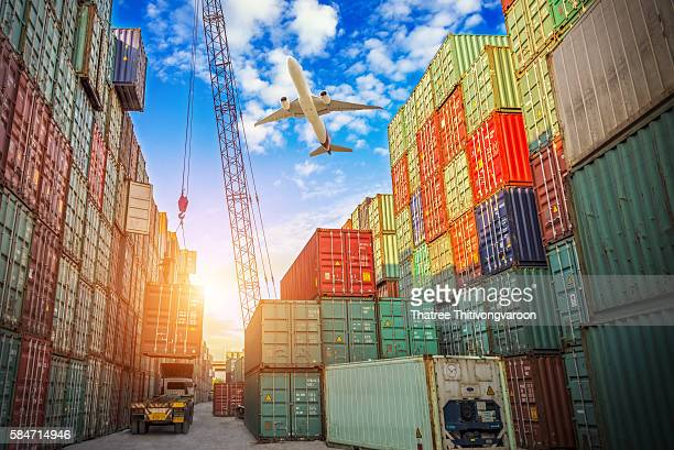 Industrial crane loading Containers in a Cargo freight ship to truck