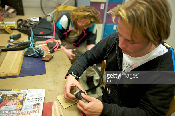 Industrial design student Lodewijk Bosman and Hidde van der Straaten work on items made from recycled bicycle parts at their workshop on May 17 2013...