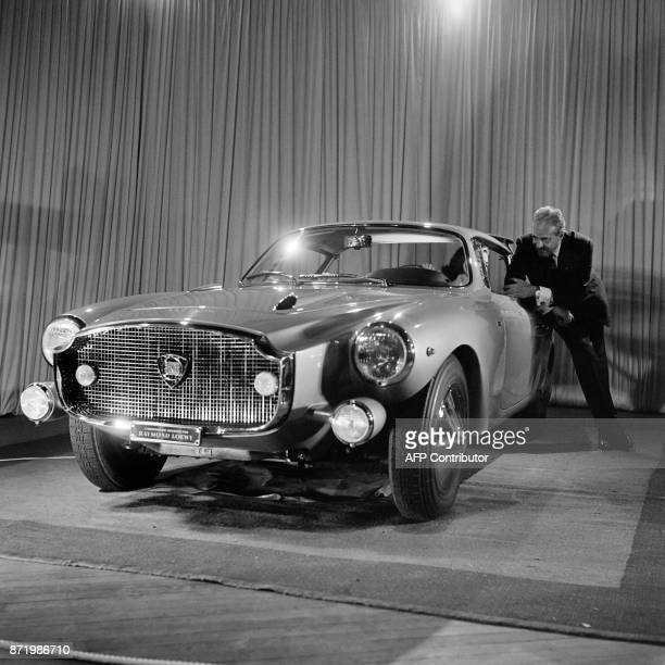 US industrial designer Raymond Loewy presents his Lancia model car in October 1960 / AFP PHOTO /