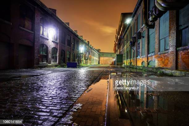 industrial district at night in lawrence massachusetts - lawrence massachusetts stock photos and pictures