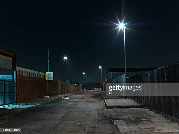 industrial district at night - 工場地帯 ストックフォトと画像