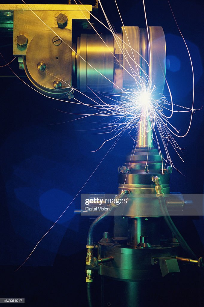 Industrial Drill in Motion Giving Off Bright Sparks : Stock Photo