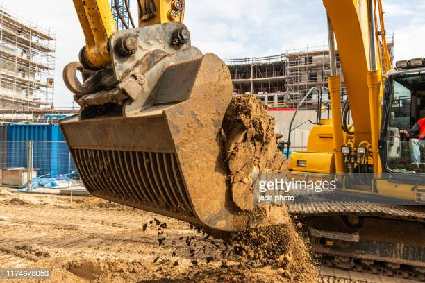 industrial earth mover scoops up a huge amount of sand - ancient civilisation stock pictures, royalty-free photos & images
