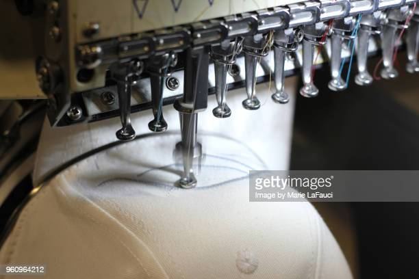 industrial embroidery machine in use - embroidery stock pictures, royalty-free photos & images