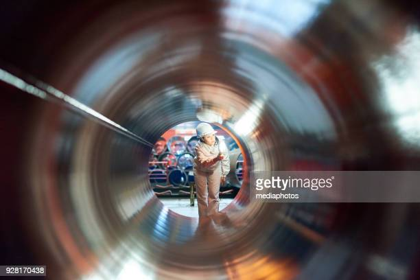 industrial engineer examining manufactured tube before selling - female streaker stock pictures, royalty-free photos & images