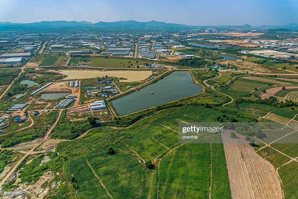 Industrial estate development and Farming Aerial photography : Stock Photo