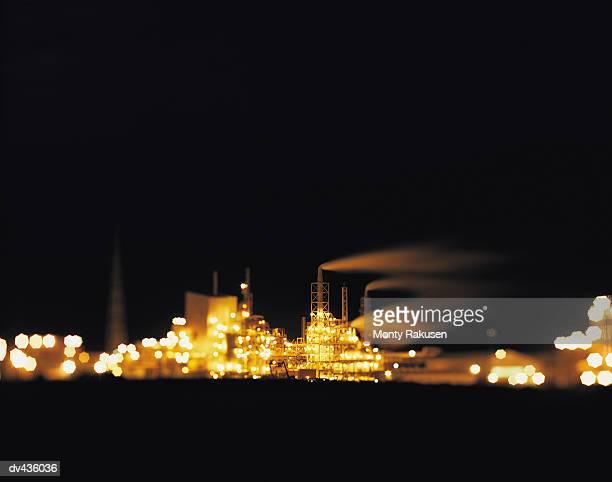 industrial factory at night - monty rakusen stock-fotos und bilder
