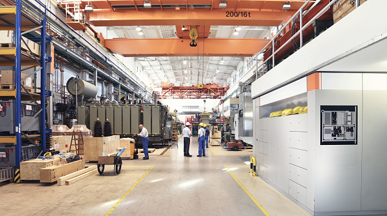 industrial factory in mechanical engineering for the manufacture of transformers - interior of a production hall 943839366