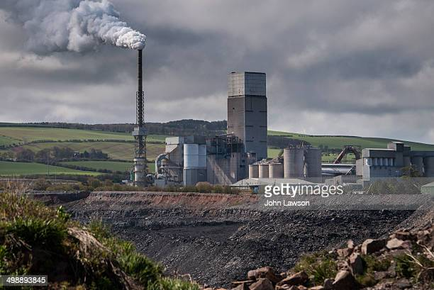Industrial image of a cement works near Dunbar, East Lothian, Scotland. In the foreground is the limestone quarry which provides the raw materials...