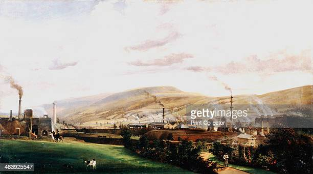 Industrial landscape Wales 19th century An ironworks clearly showing blast furnaces with flames spouting from their tops The foreground shows the...