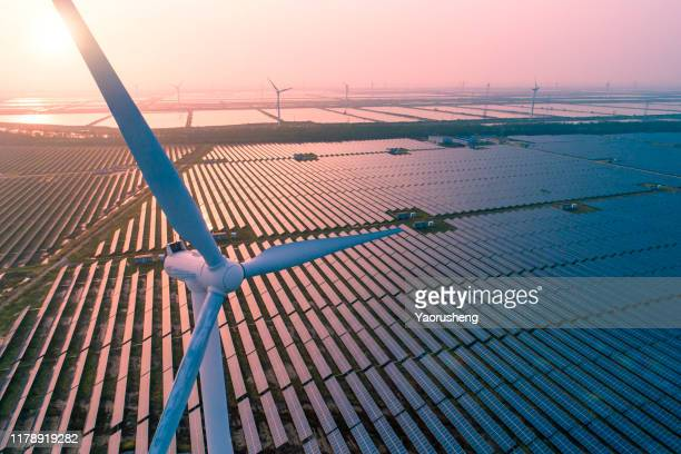 industrial landscape with different energy resources. sustainable development. - wind power stock pictures, royalty-free photos & images