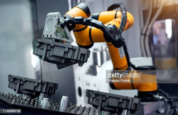industrial machine and factory robot arm - smart stock pictures, royalty-free photos & images