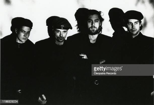 Industrial metal band Ministry LR Buzz McCoy Al Jourgensen Bill Rieflin and Paul Barker pose for a portrait in 1988 in Chicago IL