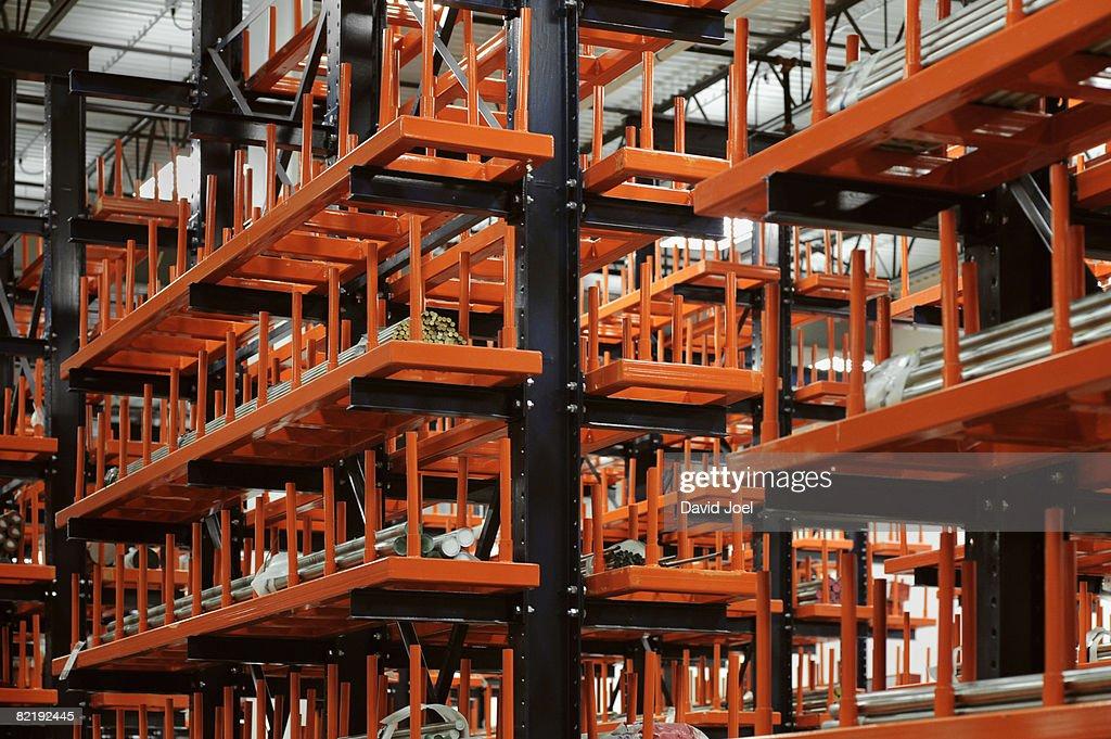 industrial metal bars on huge racks  : Stock Photo