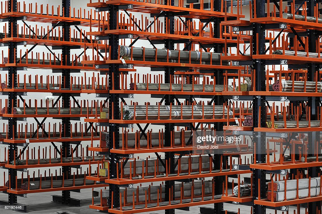 industrial metal bars on huge racks : Stock Photo