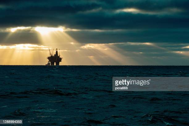 industrial oil rig offshore platform: away from a sustainable resource - gas stock pictures, royalty-free photos & images