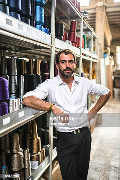 Industrial owner inside his factory