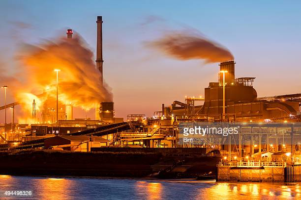 Industrial Plant on the River Illuminated at Night, Netherlands