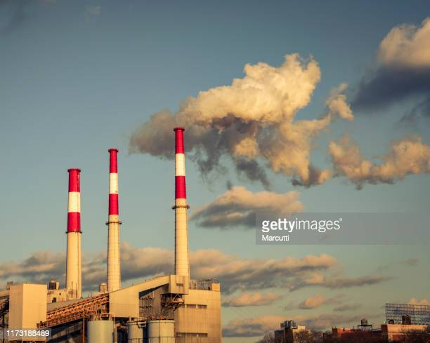 industrial pollution - chimney stock pictures, royalty-free photos & images