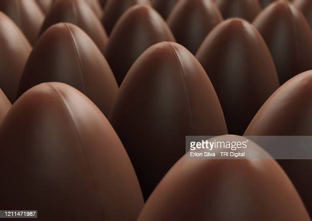 industrial production of delicious chocolate eggs for easter - イースターエッグのチョコレート ストックフォトと画像