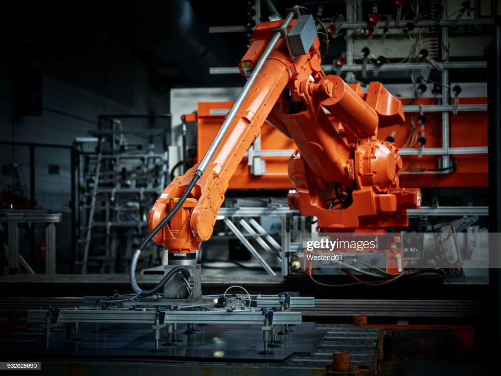 Industrial robot arm used in metalworking : Stock Photo