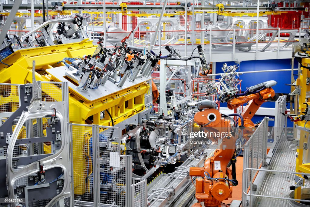 Industrial Robot Arms In A Car Factory Stock Photo - Getty
