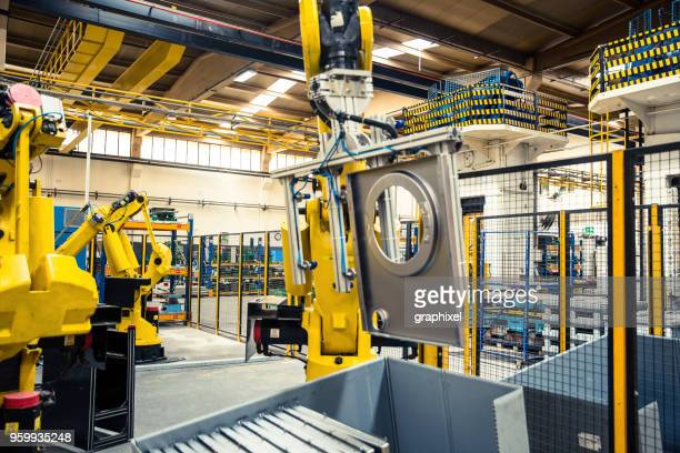 industrial robot in factory - white goods stock pictures, royalty-free photos & images