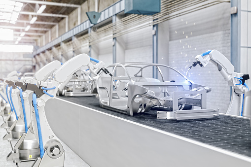 Industrial Robots At The Automatic Car Manufacturing Factory Assembly Line 1157353975