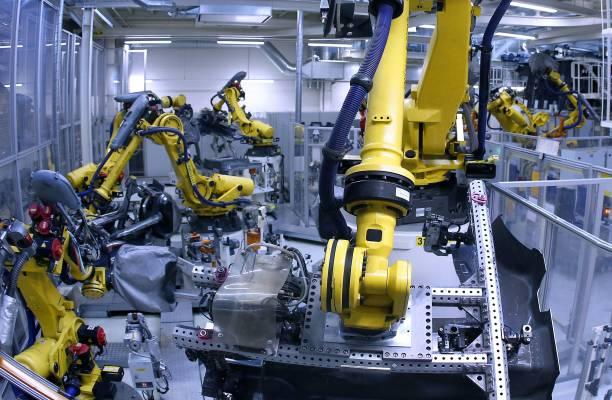 Industrial robots weld parts of chis of the Volkswagen Golf 7 ...