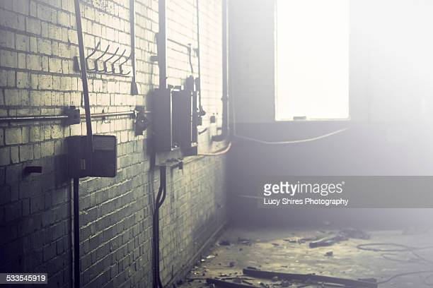 industrial room with bright light from window. - lucy shires stock pictures, royalty-free photos & images