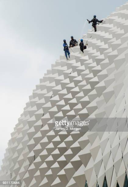 Industrial rope access workers window clean the roof of the Esplanade Theatres on the Bay on March 13 2018 in Singapore The structures have more than...